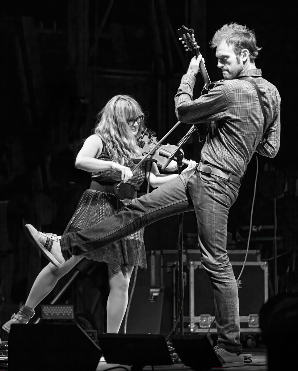 Chris Thile and Sarah Watkins 2014 Nickel Creek's Reunion Tour performance was the highlight of the 2014 Grey Fox Bluegrass Festival in Oak Hill, New York. Shot from the wings, this shot gives the appearance that Chris and Sarah are dancing and about to take to the air.