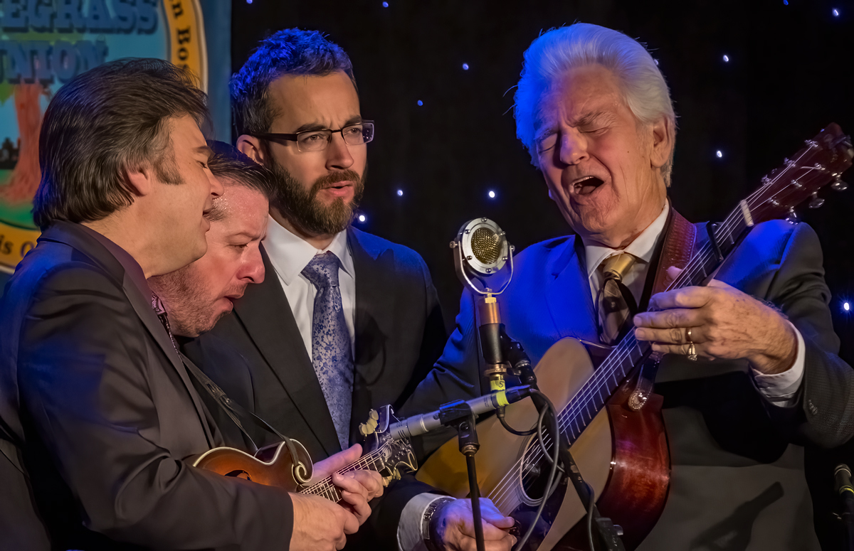 Del McCoury Band at Joe Val Bluegrass Festival 2016 Taken at the 31st Annual Joe Val Bluegrass Festival in Framingham, Massachusetts. L to R Ronnie McCoury, Jason Carter, Alan Bartram and Del McCoury singing four-part harmony on a gospel number. This shot is all about the emotion they put into their music.