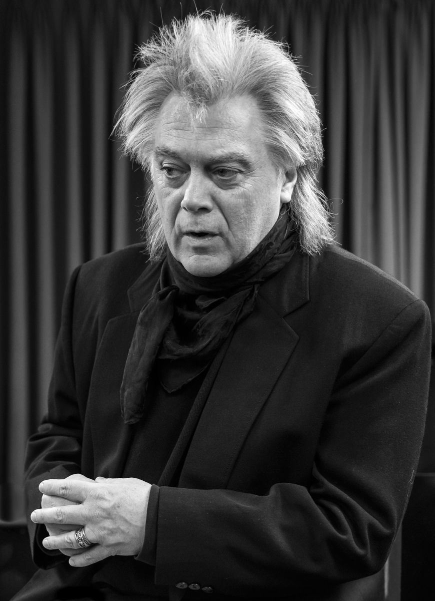 Marty Stuart at Berklee 2017 This photo was taken as Marty spoke with students about early country and bluegrass music. The contrast of his face, hands and hair against his dark suit give this image a solemn feeling that tries to capture what a keen observer and reflective person Marty is.