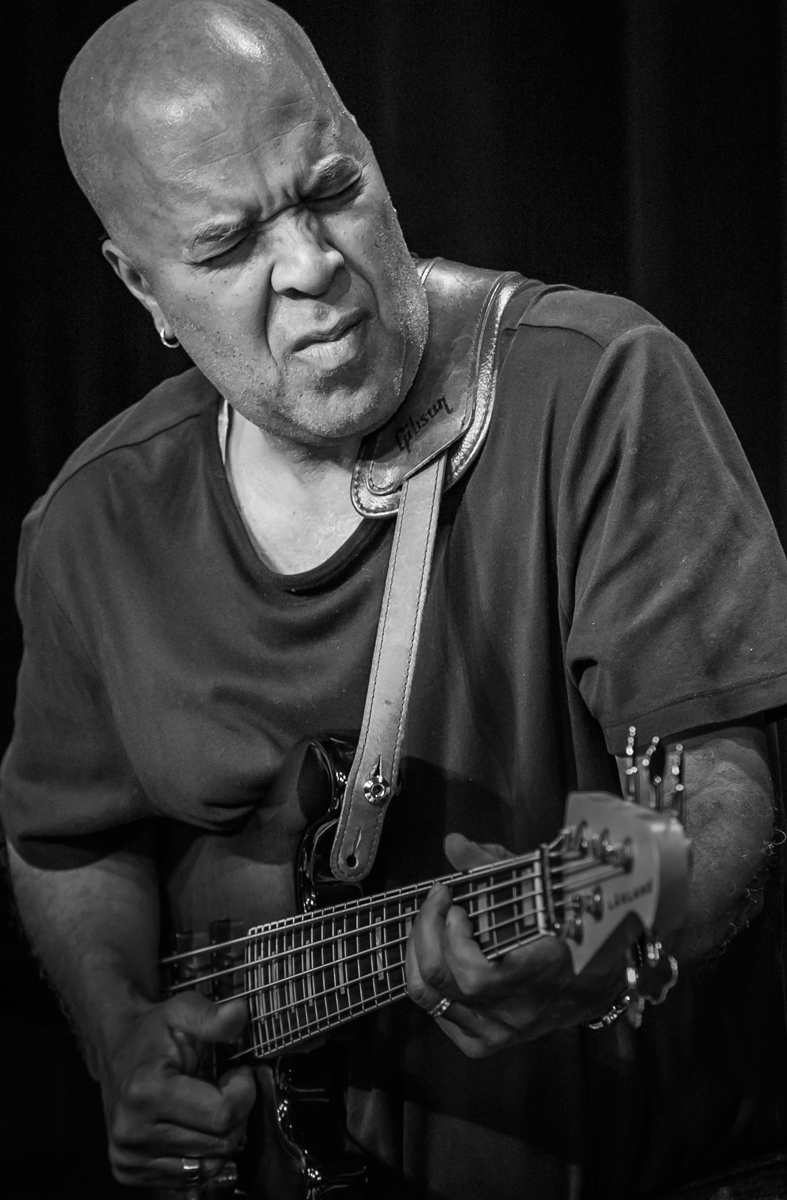 Skip Smith 2015 Contrast and light focused on Skip's face capture him feeling the groove. The strong angular lines of the neck of his bass give this composition a three-dimensional appearance.